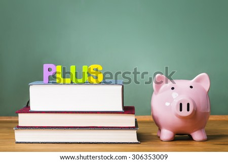 Federal PLUS Parent Loan to Undergraduate Students theme with textbooks and piggy bank and chalkboard background - stock photo