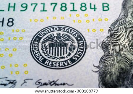 Federal reserve system symbol on hundred dollar bill closeup macro shot - stock photo