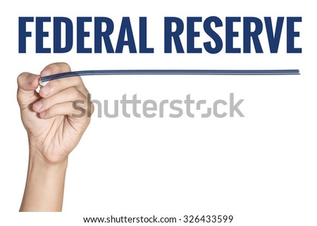 Federal Reserve word writting by men hand holding blue highlighter pen with line on white background - stock photo