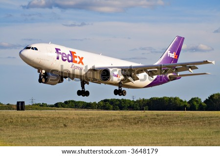 FedEx jet lands at Cleveland Hopkins Airport in Ohio. - stock photo