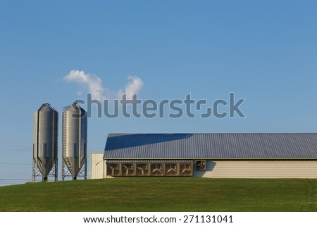 Feed bins at the end of a chicken house - stock photo
