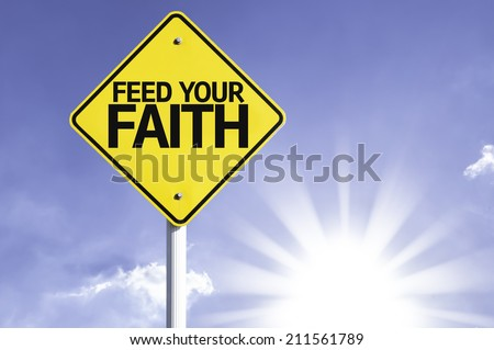 Feed your Faith road sign with sun background  - stock photo