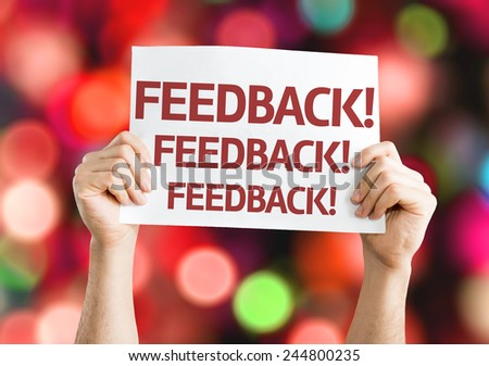 Feedback card with colorful background with defocused lights - stock photo