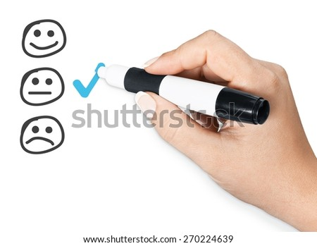 Feedback. Hand putting check mark with green marker on customer service evaluation form. - stock photo