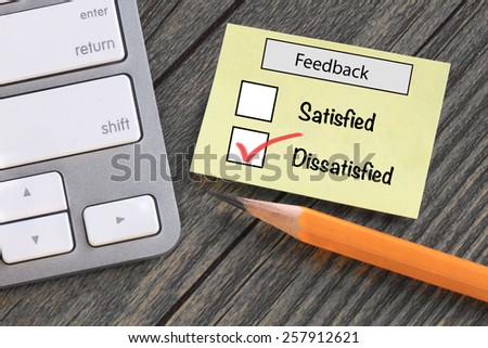 feedback in customer survey, showing dissatisfied experience - stock photo