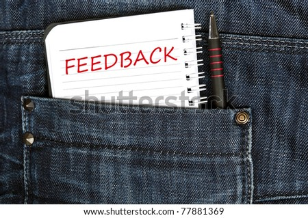 Feedback message on notepad - stock photo