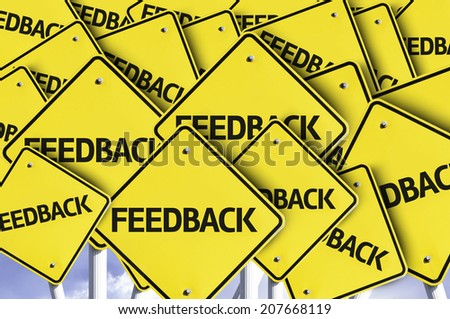 Feedback written on multiple road sign - stock photo