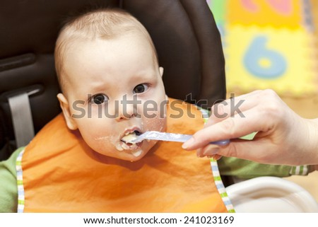 Feeding a child - stock photo