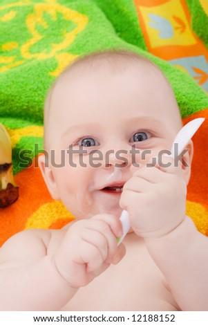 Feeding. Beautiful baby. Shot in studio. - stock photo