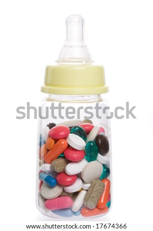 Feeding bottle filled with pills - stock photo