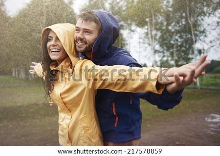 Feeling free in the rain  - stock photo