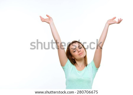 Feeling relaxed. Young attractive woman with closed eyes holding her hands up on white isolated background. - stock photo