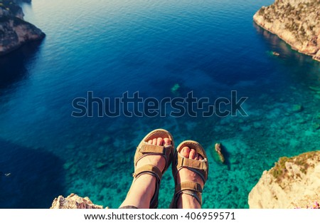 Feet above the sea bay - stock photo