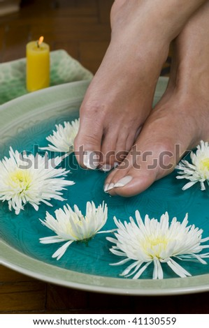 Feet enjoy a relaxing aromatherapy foot soak at day spa
