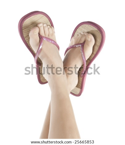 feet in Flip Flop Sandals - stock photo