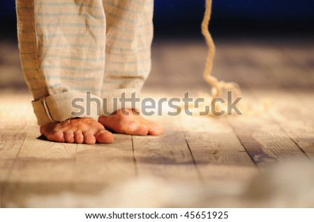feet in front of a convict in the form of suicide - stock photo