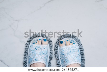 feet in quirky slippers that are also a mop, silly stuff you buy online - stock photo