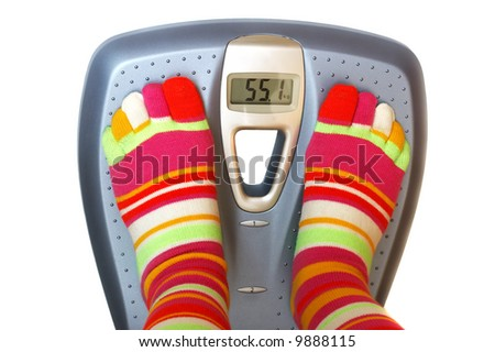 Feet in socks on a scale - stock photo