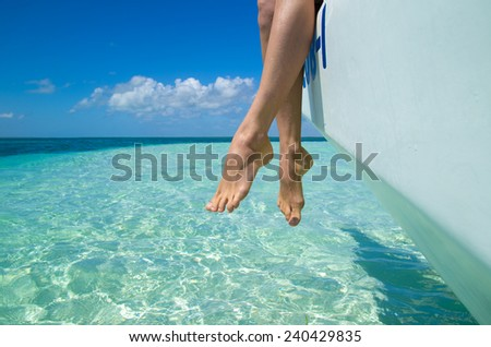 feet in the sea - stock photo