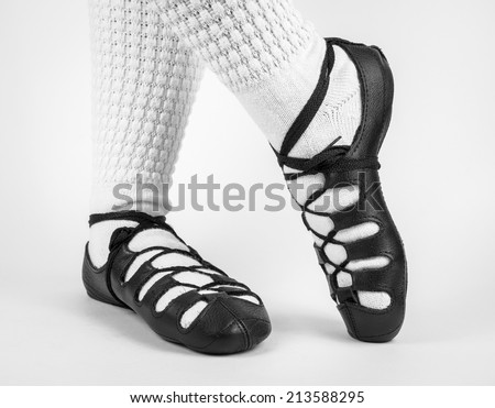 feet in traditional irish socks and shoes (pumps) on white background - stock photo