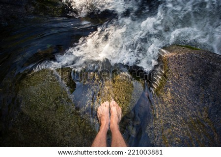 feet in waterfall  - stock photo