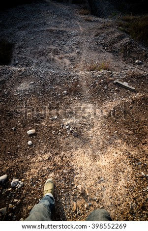 feet man in shoes on ground rock - stock photo