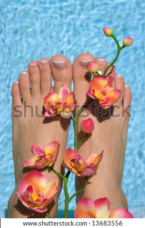 Feet near pool - stock photo