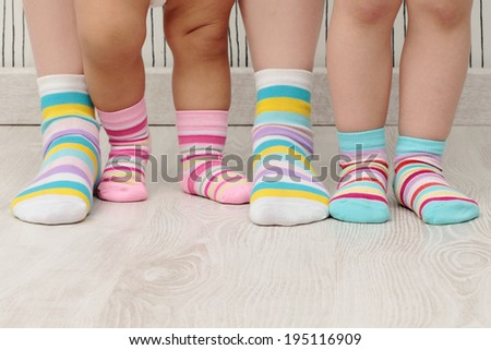 feet of a beautiful family with striped socks - stock photo