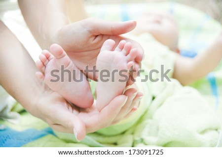 feet of a little baby - stock photo