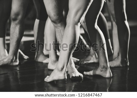 Feet of dancers. Black and white vintage style photo.
