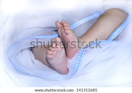 Feet of newborn child