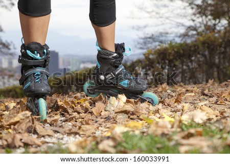 Feet of off road roller skater with in-line roller skates