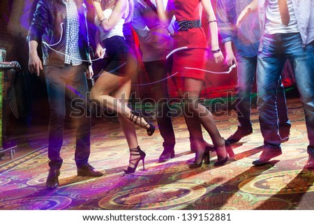 feet of people dancing on a club party. unrecognizable - stock photo