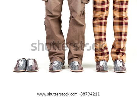 feet of players in the shoes of bowling on a white background. add - stock photo