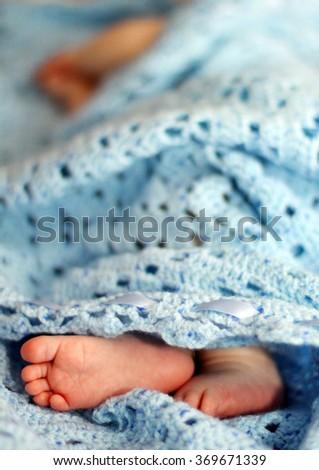 Feet of sleeping newborn - stock photo