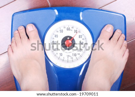 Feet on a bathroom scale - stock photo