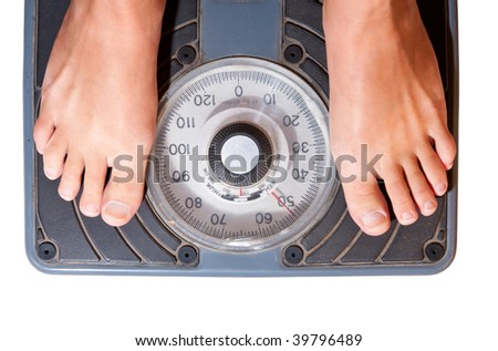 Feet on a bathroom scale isolated on white - stock photo