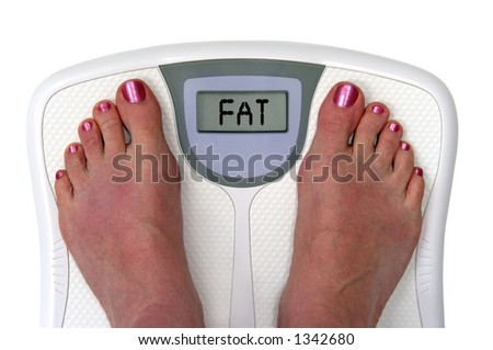 Feet on a bathroom scale with the word fat on the screen. Isolated. Include clipping path. - stock photo