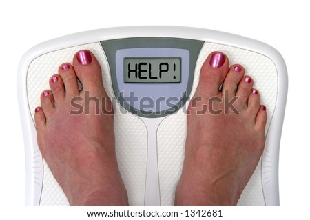 Feet on a bathroom scale with the word help! on the screen. Isolated.  Includes clipping path. - stock photo
