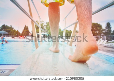 Feet on a diving board - stock photo