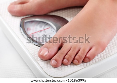 Feet on a weighing scale.Close up. - stock photo