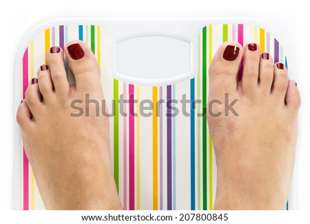 Feet on bathroom scale with blank dial copy-space isolated - stock photo