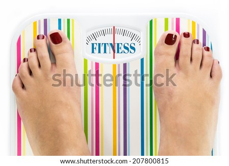 """Feet on bathroom scale with word """"Fitness"""" on dial - stock photo"""