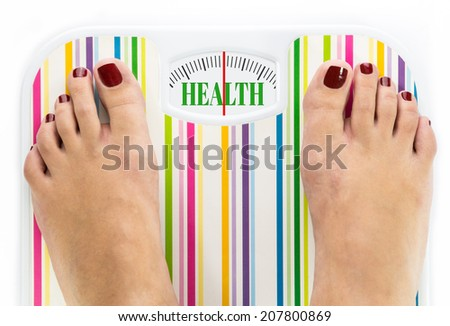 "Feet on bathroom scale with word ""Health"" on dial - stock photo"