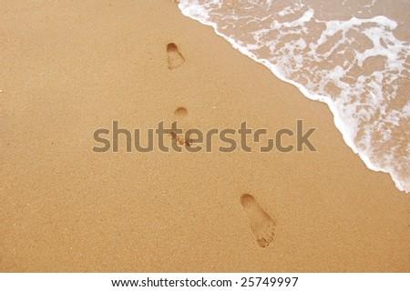 feet print on the seaside - stock photo