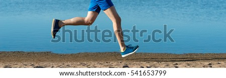 feet running men on the beach