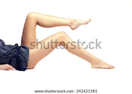 Feet spa, legs foot massage in spa. Woman feet care. Legs stockings, tights - stock photo