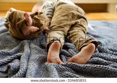 Feet two little boys, selective focus - stock photo