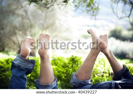 Feet up of a young  couple in love expressing relaxation and fun - stock photo