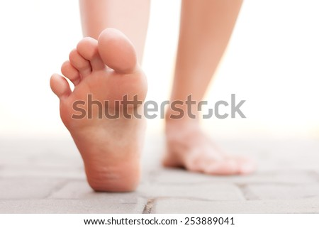 Feet walking outside - stock photo